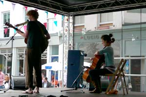 Violinist and cellist on stage at street festival