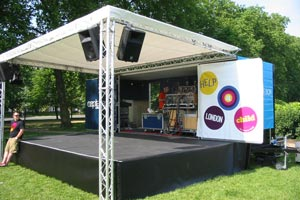 empty open air stage with speakers and sound equipment