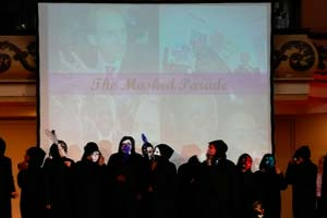 people in costume standing in front of projector screen