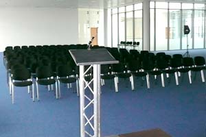 lectern, microphone and chairs set out for staff briefing